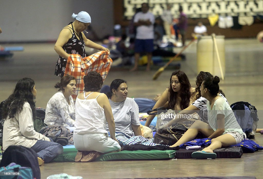 Tourists from Mexico City sleep in a shelter in Acapulco, Guerrero state, Mexico, on September 17, 2013 as heavy rains hit the country. At least 48 people were killed and thousands evacuated from towns on the Pacific and Gulf of Mexico coasts over the weekend as Tropical Storm Manuel and downgraded Hurricane Ingrid set off landslides and floods that damaged bridges, roads and homes.