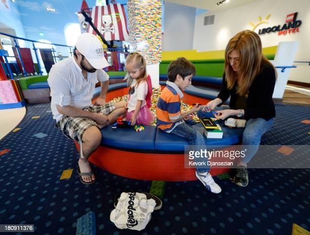 Tourists from Mexico Diego and his sister Ximena Numata play with Lego toys with their mother Carolina Numata and their uncle Sergio Esqueda in the...