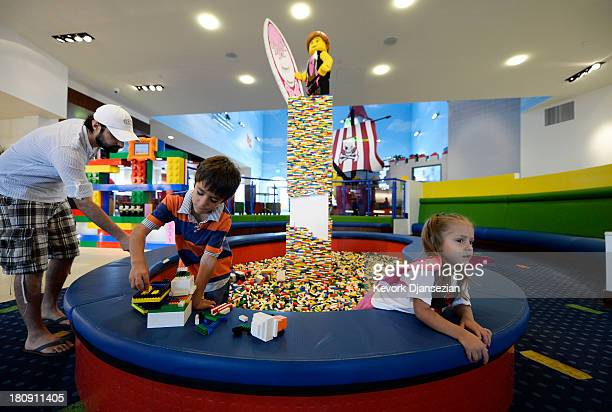 Tourists from Mexico Diego and his sister Ximena Numata play with Lego toys with their uncle Sergio Esqueda in the lobby area of North America's...