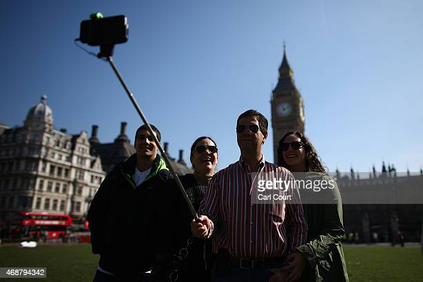 Tourists from Mexico take a family selfie photograph in front of Big Ben using a selfie stick on April 7 2015 in London England Parts of Britain...