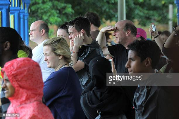 Tourists from various countres gather after arriving at a school used as an evacuation centre in Jerantut a major town in central Pahang on December...