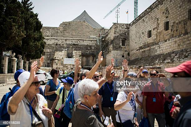 Tourists gather at the church of Nativity on May 20 2014 in Bethlehem West Bank Pope Francis is due to make his first visit to the Holy Land as...