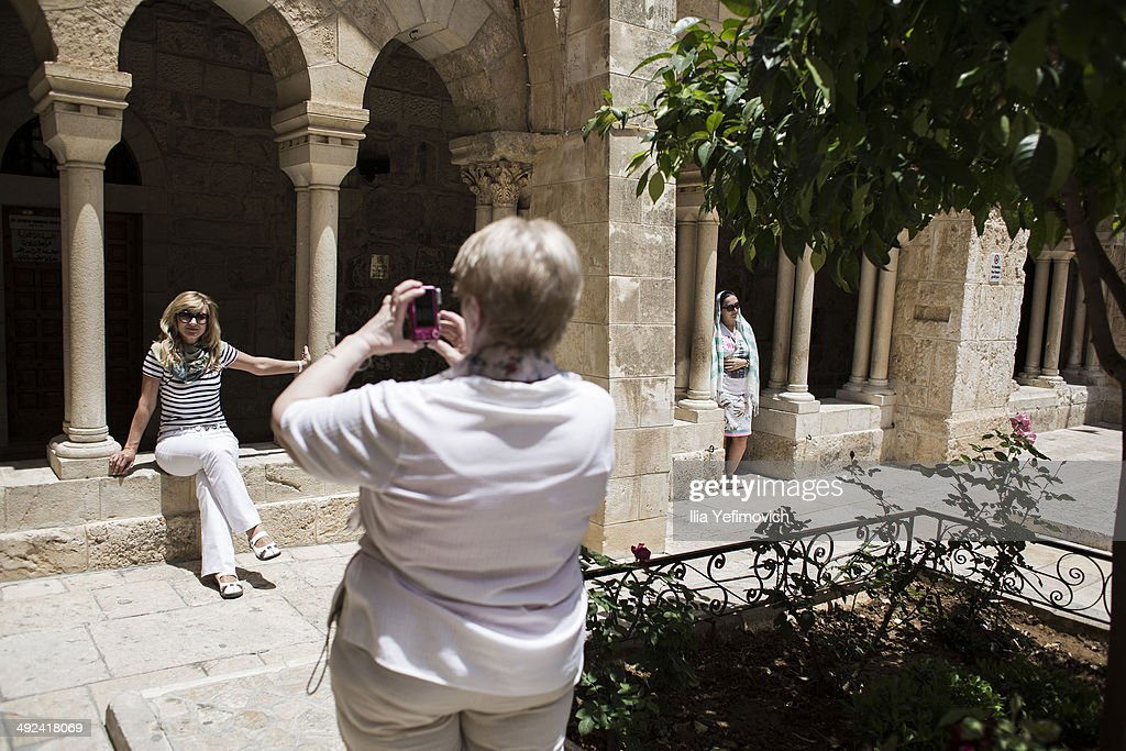 Tourists gather at the church of Nativity on May 20, 2014 in Bethlehem, West Bank. Pope Francis is due to make his first visit to the Holy Land as pontiff and will visit both the West Bank and Israel this coming Sunday. The Pope will celebrate two public Masses during his visit, one in Amman, Jordan and the other in Manger Square in Bethlehem.
