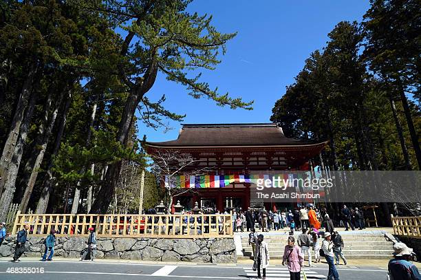 Tourists gather at the newly reconstructed Garan Chumon gate for the memorial ceremony at Mount Koya on April 2 2015 in Koya Wakayama Japan Mount...