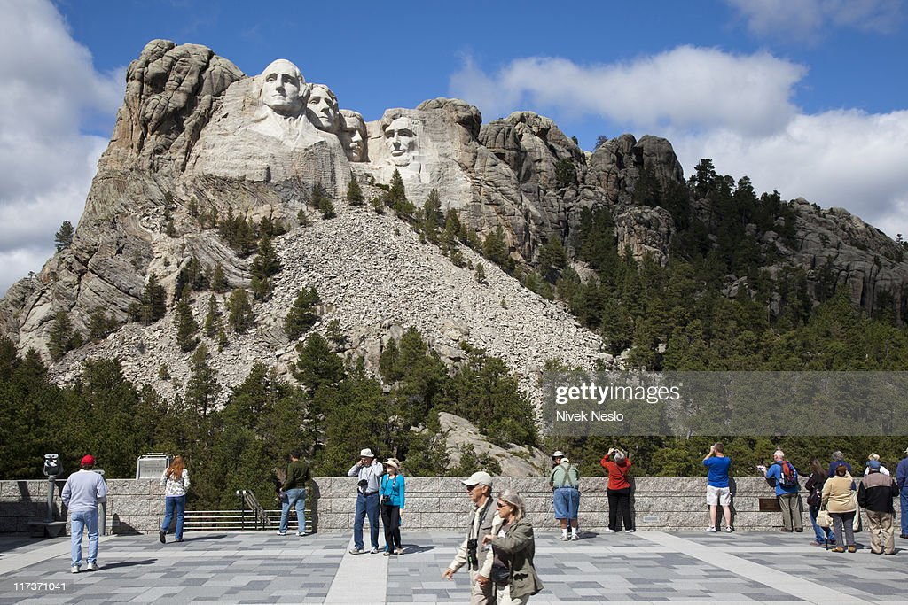 Tourists Gather at View of Mount Rushmore : Stock Photo