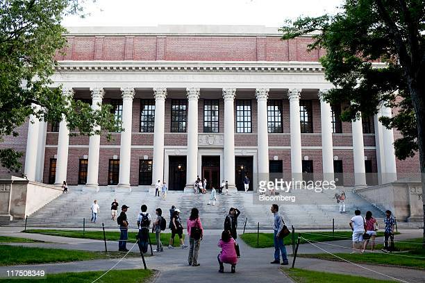 Tourists gather in front of the Harry Elkins Widener library on the campus of Harvard University in Cambridge Massachusetts US on Tuesday June 21...
