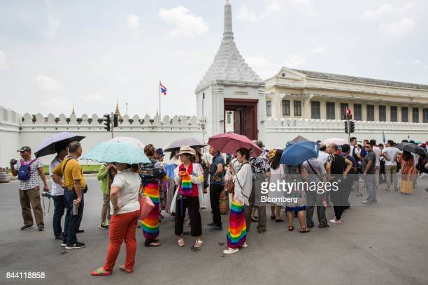 Tourists gather near the ceremonial ground for King Bhumibol Adulyadej at Sanam Luang park in Bangkok Thailand on Friday Sept 8 2017 The Kingdom of...