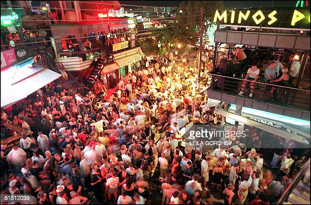 Tourists gather on the main square of the Cyprus popular holiday beach resort of Ayia Napa early 19 June 2001 Ayia Napa is the most popular resort in...