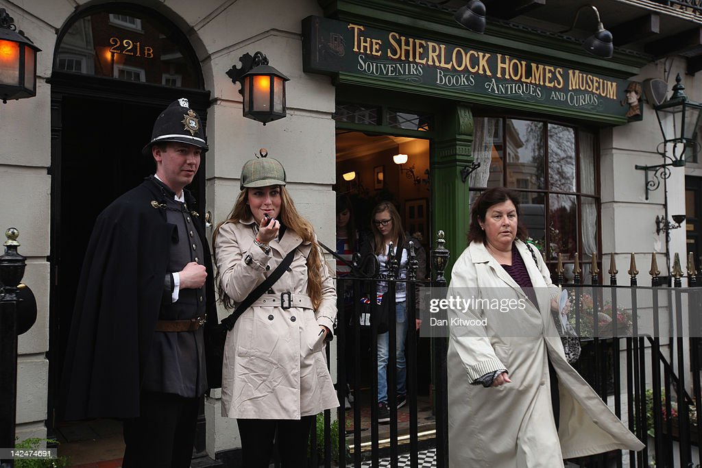 Tourists gather outside the former home of the fictional Character Sherlock Holmes on April 5, 2012 in London, England. 221B Baker Street is the London address of the fictional detective Sherlock Holmes, which was created by author Sir Arthur Conan Doyle.