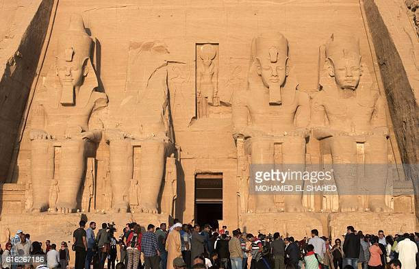 Tourists gather outside the temple of Abu Simbel south of Aswan in upper Egypt to witness the sun illuminate the inner sanctuary on October 22 2016 /...