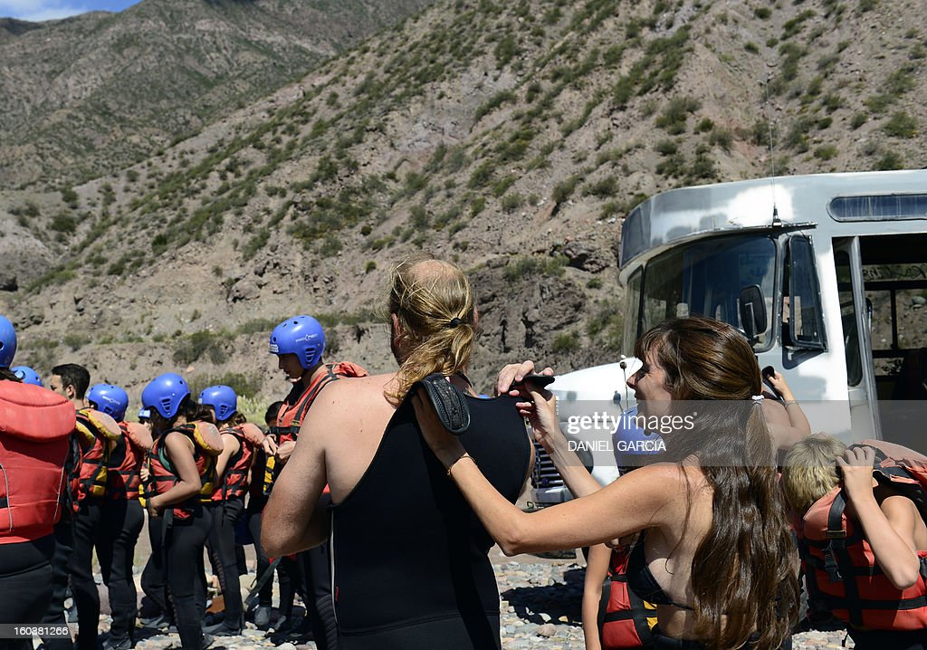 Tourists gear up to go rafting through the rapids in the muddy waters of the Mendoza river near Potrerillos, Argentina on January 29, 2013.