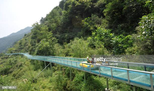 Tourists go down a giant water slide on August 21 2017 in Lingshou County of Shijiazhuang Hebei Province of China The 1260meterlong drifting...