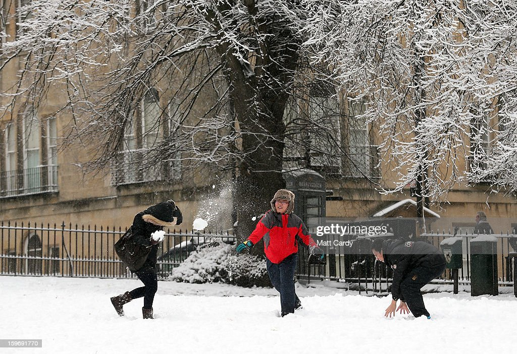 Tourists have a snow ball fight near the Royal Crescent overlooking Victoria Park on January 18, 2013 in Bath, England. Heavy snow is bringing widespread disruption to many parts of the UK.