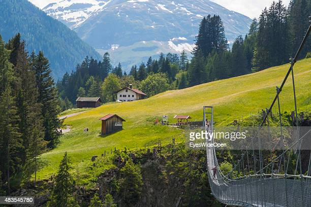 Tourists hike along the mountain trail to Cafe Uta along the Lech track the Holzgau suspension bridge and the Simms Waterfall on May 04 2015 in...