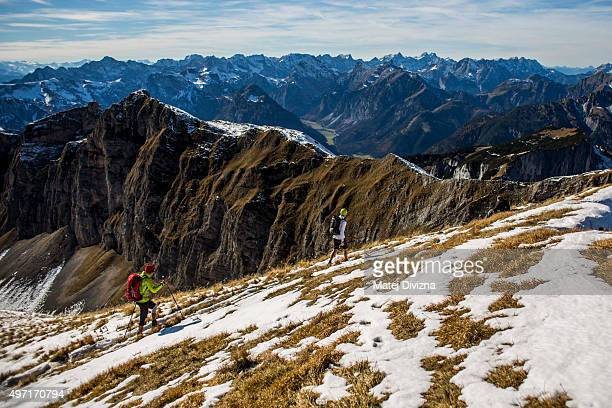 Tourists hike in the Rofan mountain range in central Tyrol on October 24 2015 near Maurach Austria The area which includes Achensee lake and the...