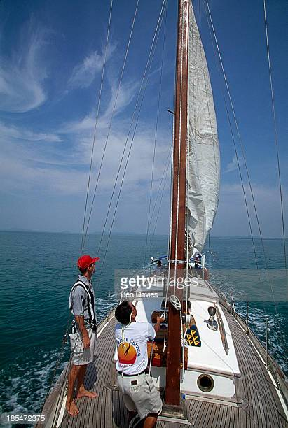 Tourists hoist the sail on a luxury yacht sailing around the islands of the Ko Chang National Marine Park The park is made up of around 50 islands...
