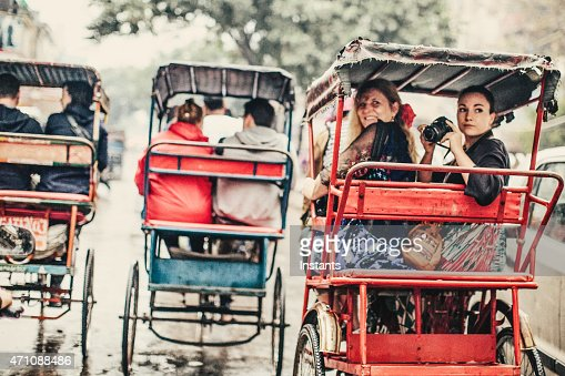 Tourists in a Rickshaw