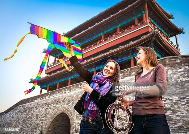Tourists in Beijing launching kite