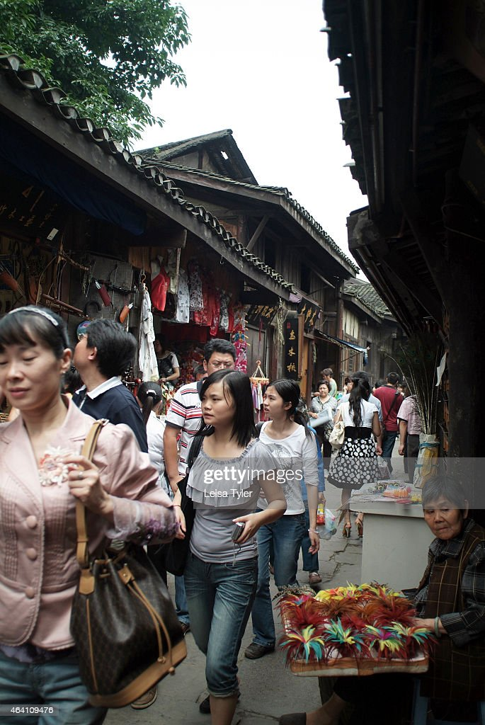 Tourists in Ciqikou a heritage town built during the Ming and Qing Dynasties an hour's drive outside of Chingqing Meaning 'Place of porcelain harbor'...