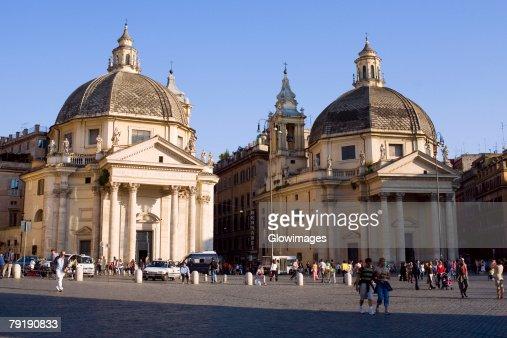 Tourists in front churches, Santa Maria Dei Miracoli, Santa Maria Di Montesanto, Piazza Del Popolo, Rome, Italy : Stock Photo