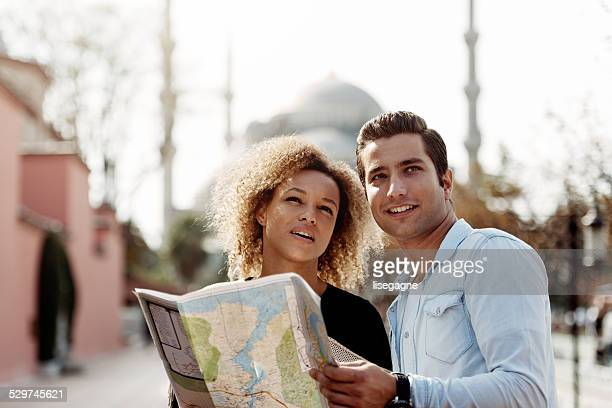 Tourists in front of Blue Mosque,looking at city map