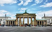 Tourists In Front Of Brandenburg Gate Against Sky