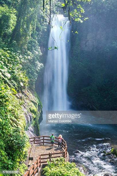 Tourists in front of La Paz waterfall, Costa Rica
