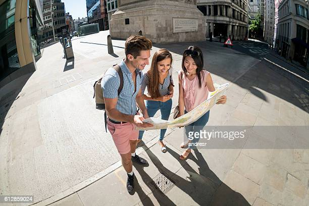 Tourists in London looking at a map