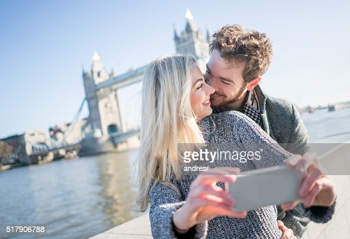 Tourists in London taking a selfie