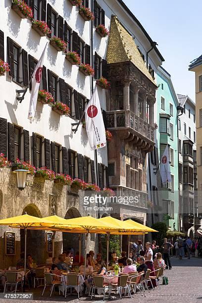 Tourists in pavement cafe in Herzog Friedrich Strasse Innsbruck the Tyrol Austria