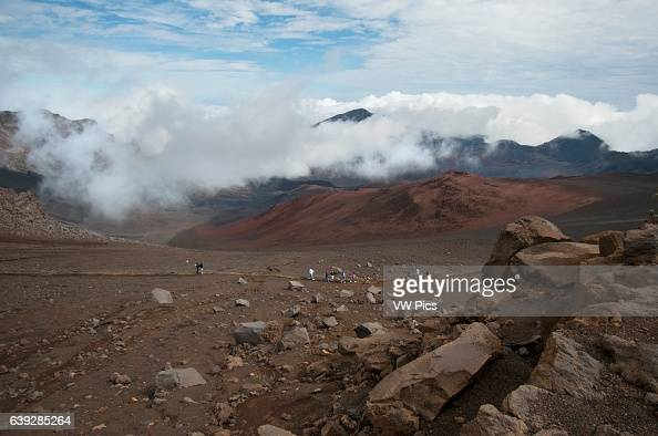 Tourists in Summit of Puu Ulaula Maui Hawaii Summit of Puu Ulaula with departing several trekings foot or horseback to descend 900 meters into the...
