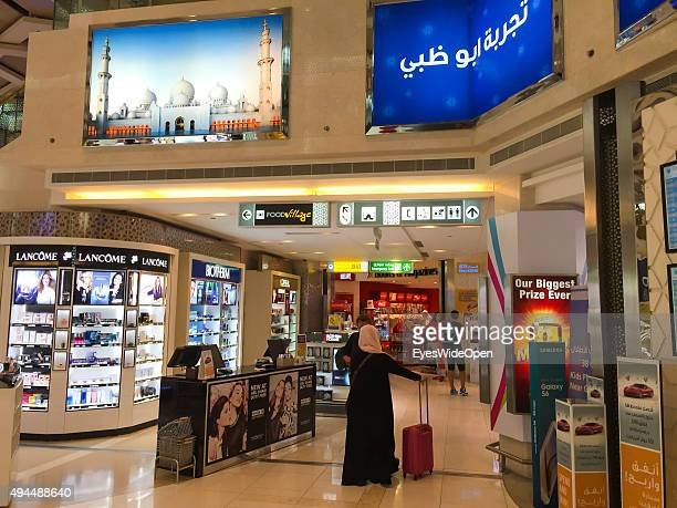 Tourists in the duty free shopping area at International Airport Abu Dhabi on September 22 2015 in Abu Dhabi United Arab Emirates