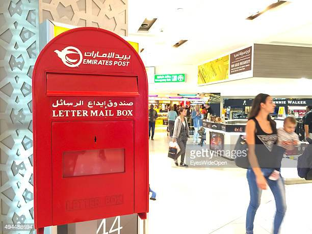 Tourists in the duty free shopping area with a Emirates Post letter mail box at International Airport Abu Dhabi on September 22 2015 in Abu Dhabi...