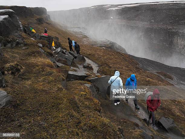 Tourists in the rain at Dettifoss