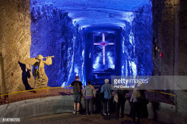 Tourists in the Salt Cathedral of Zipaquira is an underground Roman Catholic Church / Cathedral built 200m down in the tunnels of a salt mine in a...