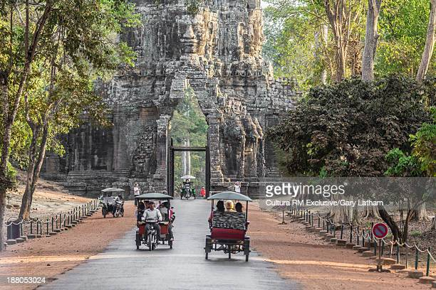 Tourists in Tuk Tuk, Angkor Thom, Cambodia