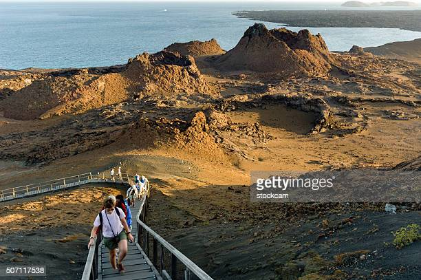 Tourists in volcanic landscape, Galapagos Islands