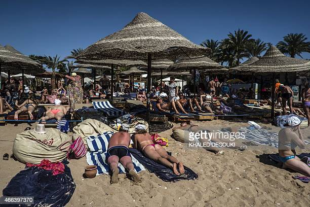 Tourists lay on deck chairs at a beach resort on March 15 2015 in Egypt's Red Sea resort of Sharm elSheikh AFP PHOTO / KHALED DESOUKI