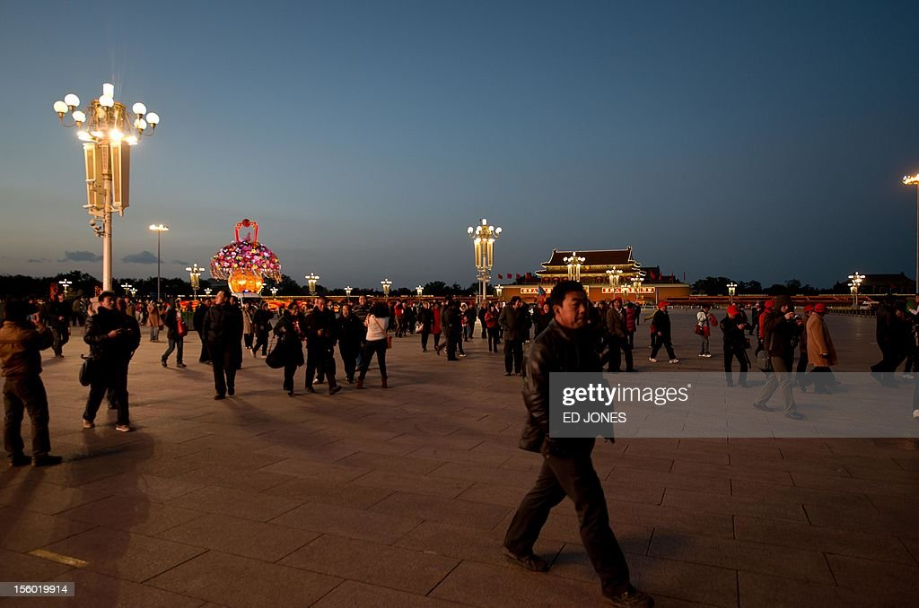 Tourists leave Tiananmen Square after the daily flag-lowering ceremony in Beijing on November 11, 2012. The week-long Communist Party Congress, held every five years, will end with a transition of power to Vice President Xi Jinping, who will govern for the coming decade amid growing pressure for reform of the communist regime's iron-clad grip on power. AFP PHOTO / Ed Jones