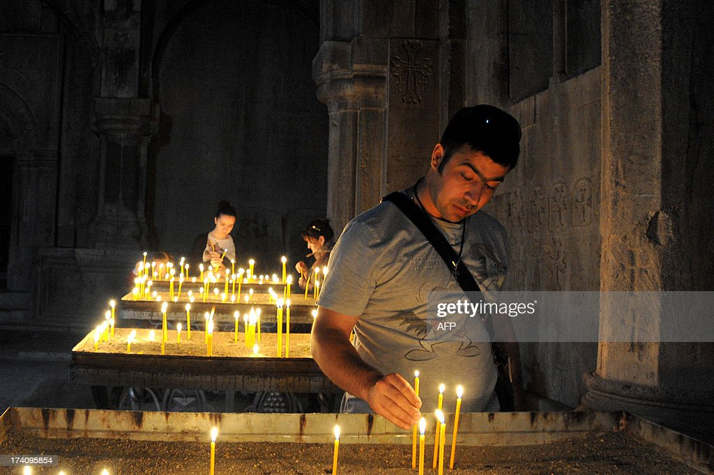 Tourists light candles as they visit the 13th century's St.John Cathedral in Gandzasar monastery about 45 km from city of Stepanokert in Armenian-controlled Azerbaijani region of Nagorny Karabakh on June 27, 2013. A growing number of foreign tourists are heading to the breakaway territory -- which is not recognised by any state -- and say they are seeing a different side to its war-scarred image. Wandering around the region's largest town Stepanakert as part of a tour group whose members come from places ranging from Turin to Taiwan, French chemist Jordan Nahoum said that while he knew all about Nagorny Karabakh's bloody past, he was surprised by what he found.