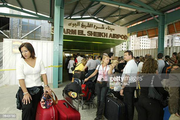 Tourists line up for security checks at Sharm alSheikh airport on the Red Sea before boarding charter flights 04 January 2004 Search teams combed the...