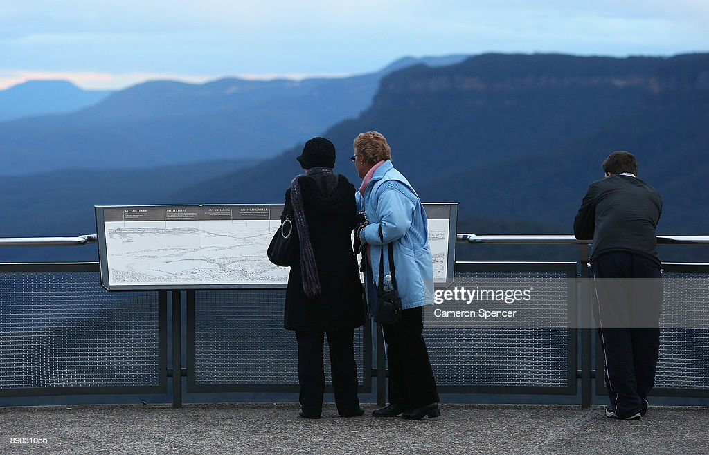 Tourists look at a map of the Blue Mountains from Echo Point on July 15, 2009 in Katoomba, Australia. Missing backpacker Jamie Neale was found earlier today after surviving 12 days lost in the Blue Mountains near Katoomba suffering from only dehydration and exposure.