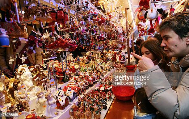Tourists look at Christmas decorations 24 November 2007 during the opening to the public of the Strasbourg Christmas market which is the largest and...