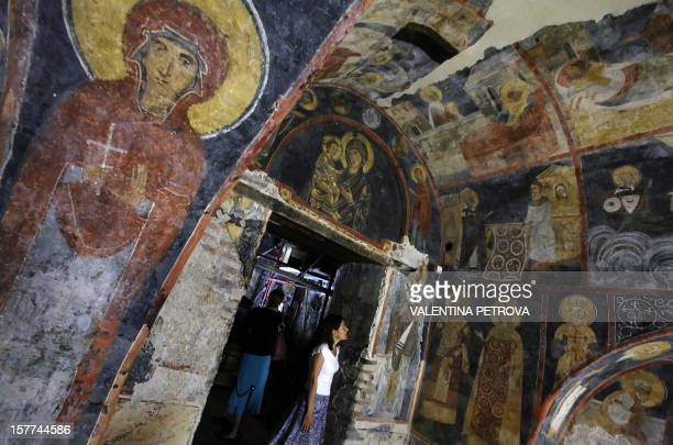 Tourists look at icon paintings in Boyana Church dated back to early 11th century undergoing restoration and recently opened for visitors in Sofia 06...
