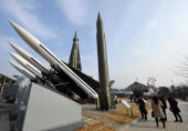 Tourists look at replicas of North and South Korean missiles at the Korea War Memorial in Seoul on February 3 2009 North Korea seems to be preparing...