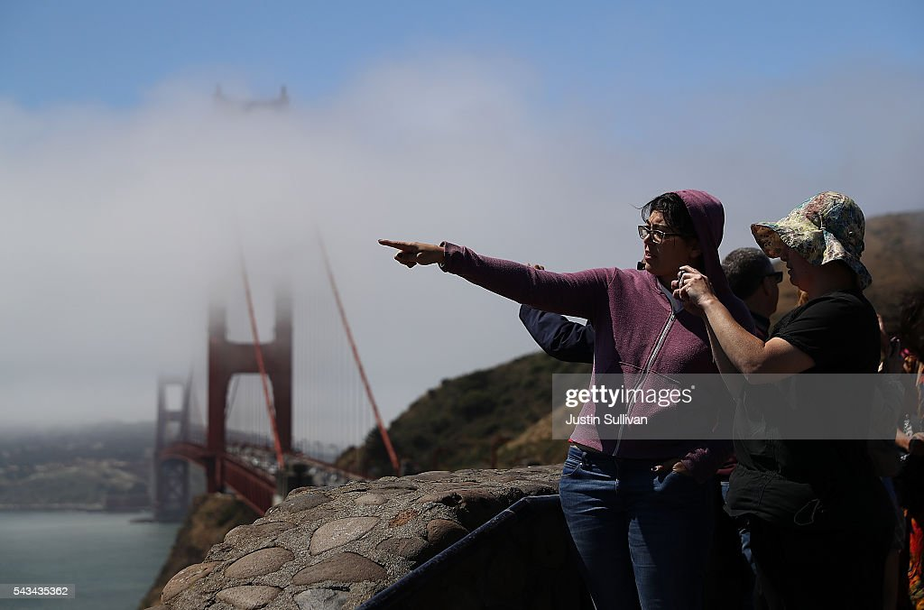 Tourists look at the Golden Gate Bridge on June 28, 2016 in Sausalito, California. A new video that allegedly supports ISIL has emerged on the internet shows San Francisco's iconic Golden Gate Bridge as well as the office building at 555 California.