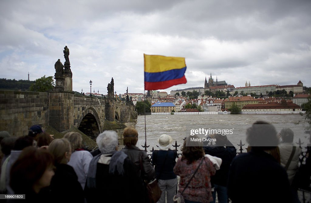Tourists look down at the flooded Vltava river near the Charles Bridge on June 4, 2013 in Prague, Czech Republic. After days of heavy rainfall, rivers have flooded in the centre of Prague forcing people to evacuate and the risk or serious damage to the historic city. Seven people have been killed and several are missing across the country as rivers continue to rise throughout western, southern and nothern Bohemia.