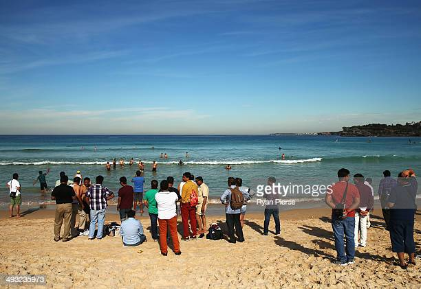 Tourists look on at Bondi Beach on May 23 2014 in Sydney Australia Sydney is experiencing it's hottest May on record already recording it's hottest...