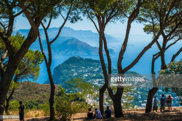 Tourists look out over Capri from Monte Solaro