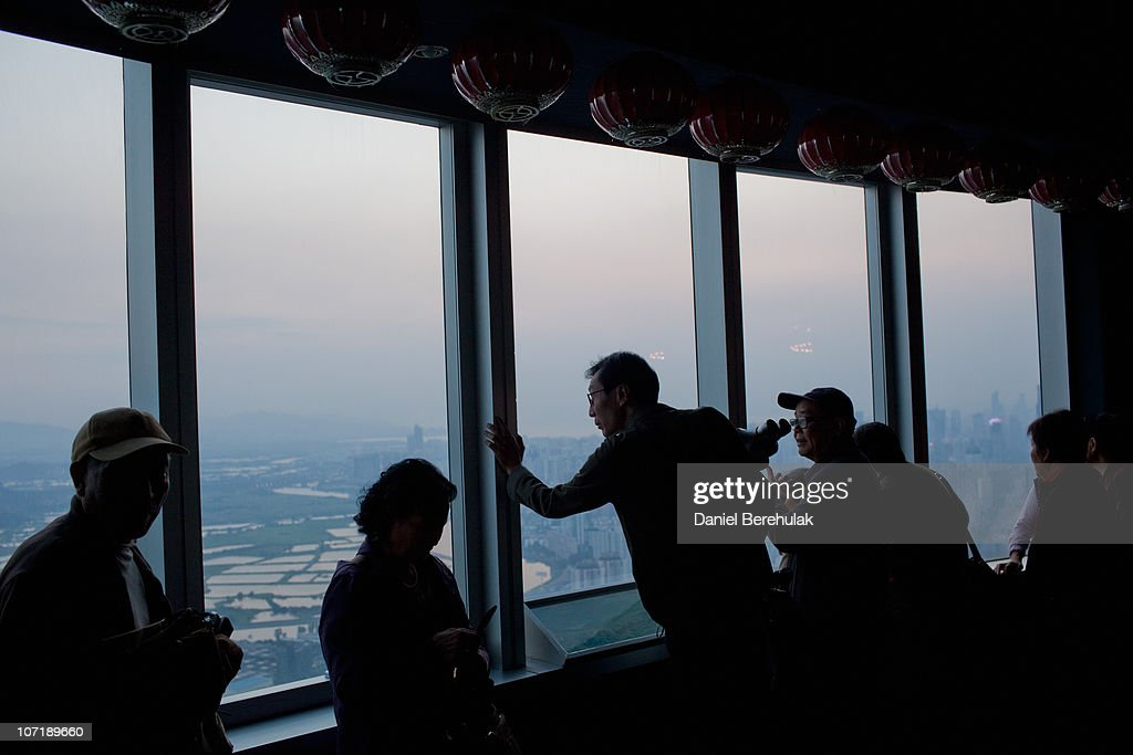 Tourists look out over the Shenzhen skyline from the 69th floor of the Shun Hing Square building on November 28, 2010 in Shenzhen, China. According to the US Commercial Service, Shenzhen is one of the fastest growing cities in the world. Home of the Shenzhen Stock Exchange and the headquarters of numerous technology companies, the now bustling former fishing village is considered southern China's major financial centre.